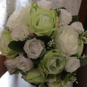 - A wedding bouquet of green and white artificial silk roses