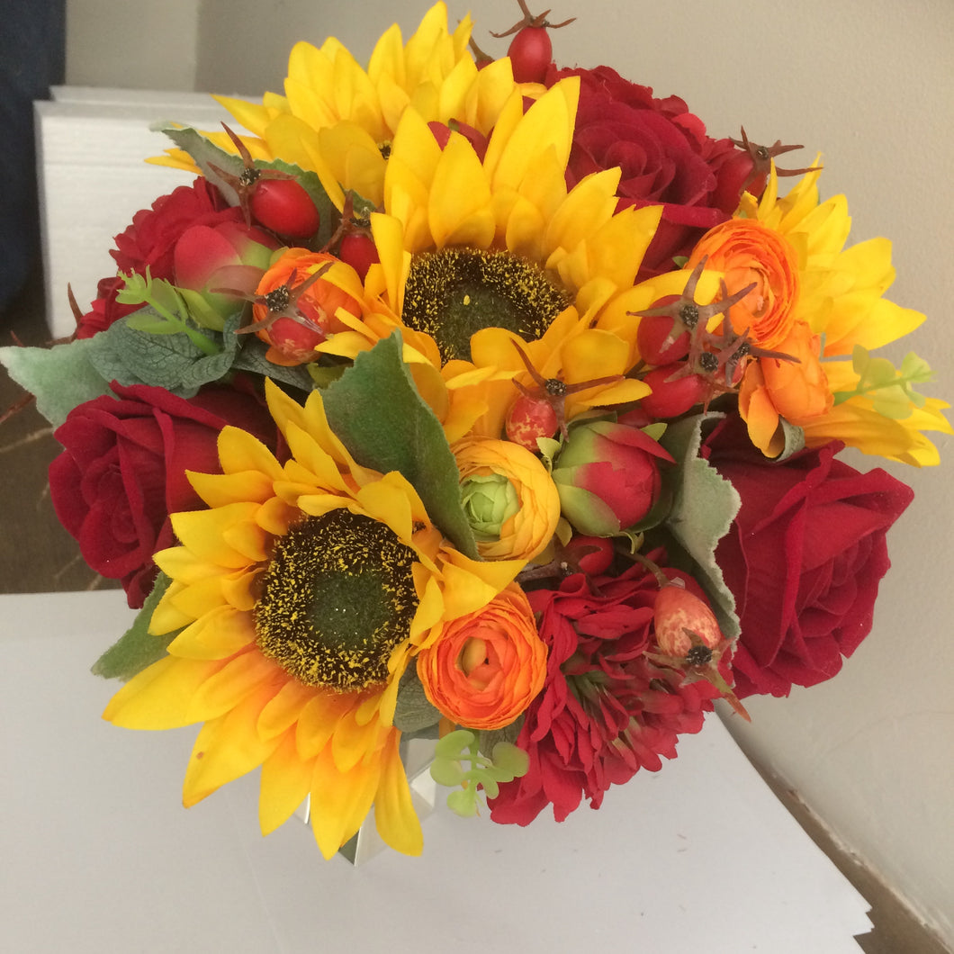 a wedding bouquet of red and yellow flowers