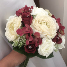 a wedding bouquet of cream, ivory & burgundy artificial roses & hydrangea