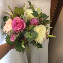 A wedding bouquet collection featuring ivory & Violet silk roses