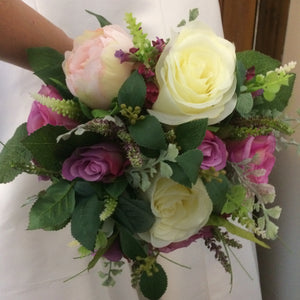 - A wedding bouquet collection featuring ivory & Violet silk roses