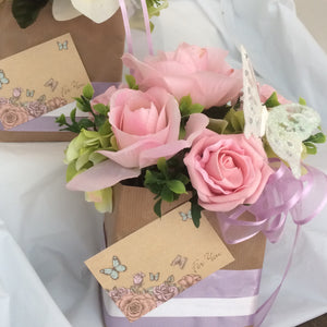 pale pink silk roses in gift bag