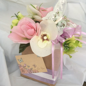 artificial orchids and rose in gift bag