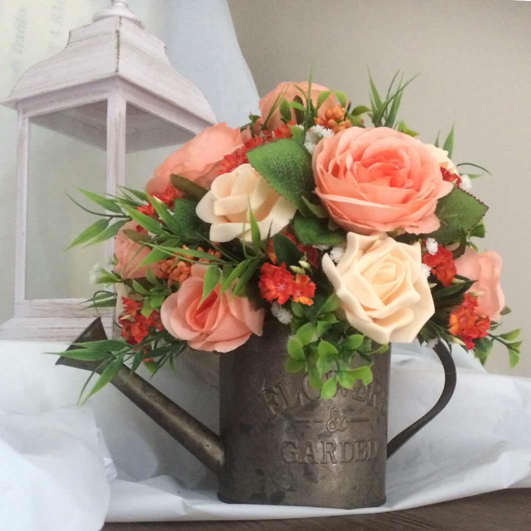 artificial flower arrangement in watering can