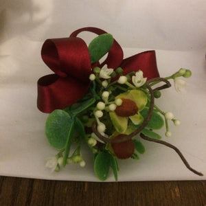 A buttonhole featuring a hypericium berries and gypsophila