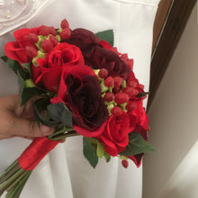 a wedding bouquet of red and burgundy silk roses & hypericum