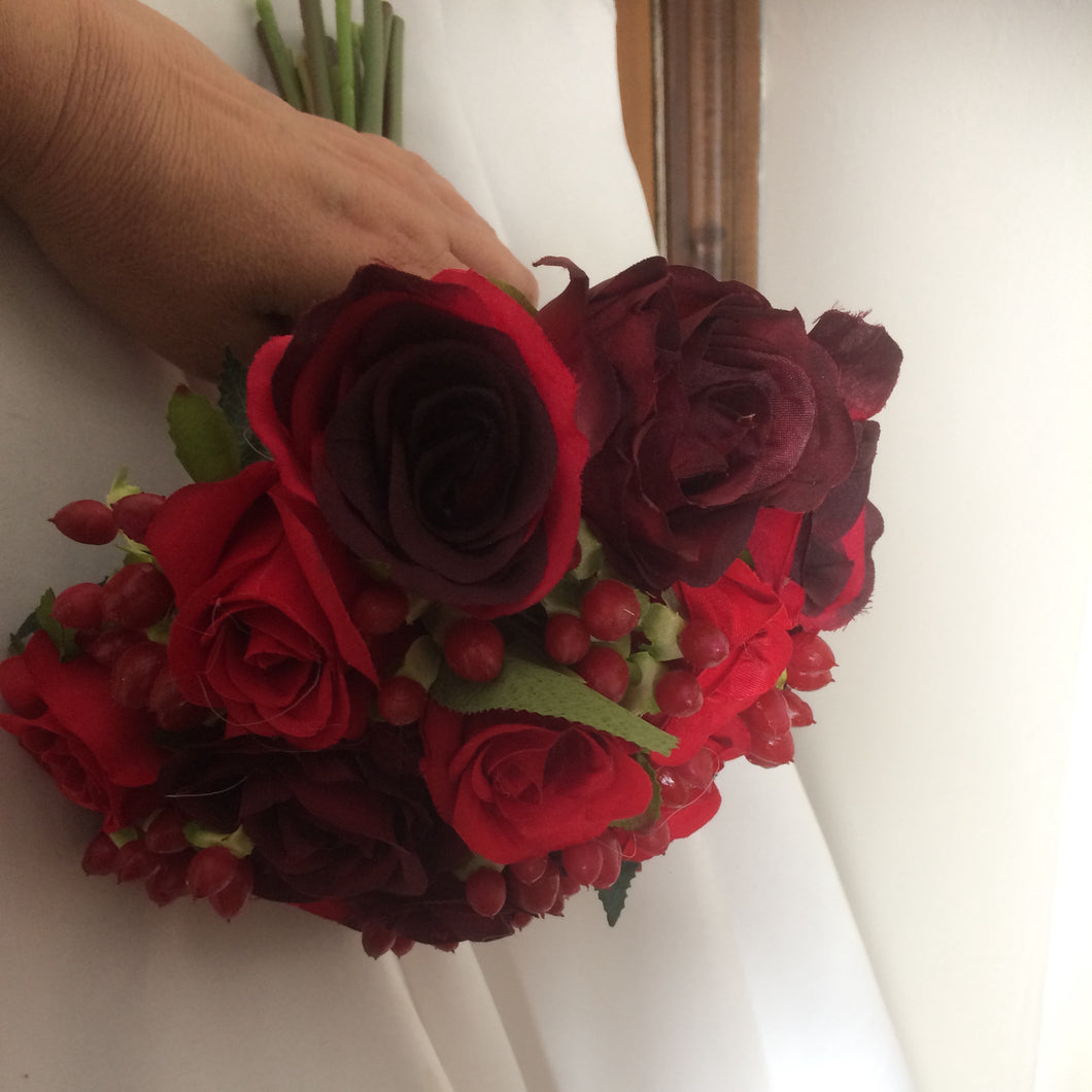 handtied wedding bouquet of red and burgundy roses