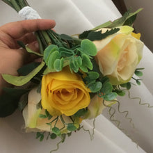 A wedding bouquet of yellow and champagne silk roses