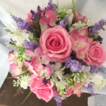 pink and purple artificial silk flowers arranged in a posy style