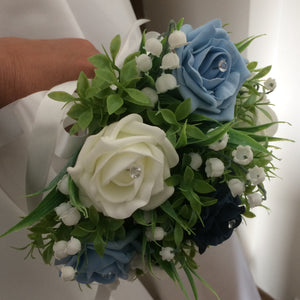 a wedding bouquet collection of roses and lily of the valley