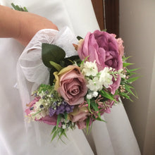 a bridal bouquet of ivory dusky pink and mauve artificial silk flowers
