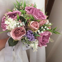 wedding bouquet of dusky pink and mauve artificial flowers