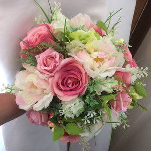 artificial wedding bouquet of pink silk flowers