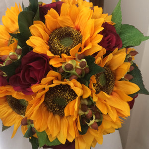 a bouquet collection featuring artificial hypericum, roses & sunflowers