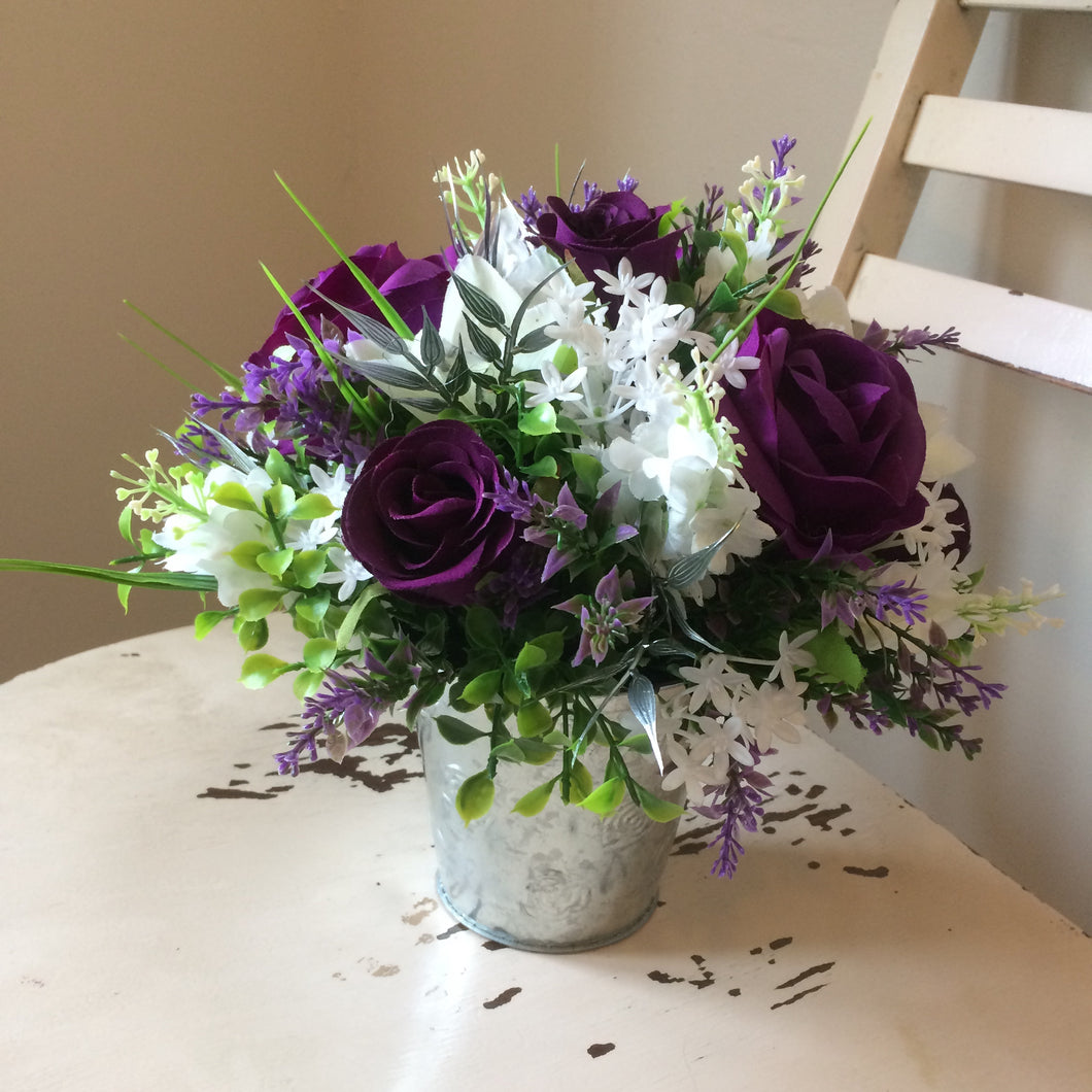 flower arrangement of silk artificial flowers
