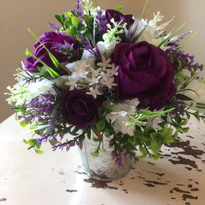 a flower posy arrangement of purple and ivory flowers
