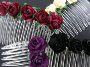 Clear plastic hair comb decorated with dainty artificial roses