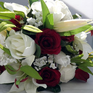 wedding posy bouquet of red ivory artificial silk roses lilies and foliage