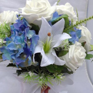artificial wedding bouquet of blue and white flowers