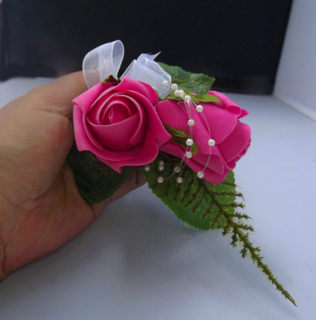 artificial wedding buttonhole features two cerise foam roses