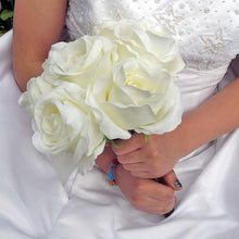 A wedding bouquet of artificial silk large ivory roses