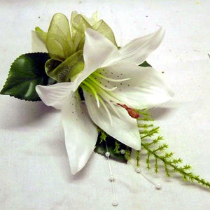 wedding buttonholes ivory lily with organza bow