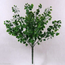a large bush of grey green plastic foliage