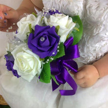 flower girl holding a bouquet of purple and ivory foam roses
