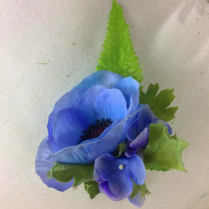 buttonhole featuring a blue anenome and hydrangea