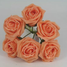 a wedding corsage featuring foam roses in a choice of 35 colours
