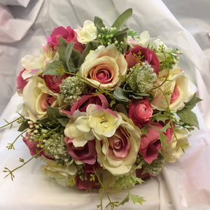 a silk bouquet of pink and cream flowers