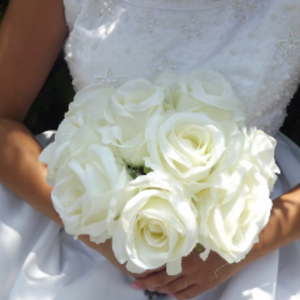 - A brides bouquet featuring artificial silk large ivory silk roses