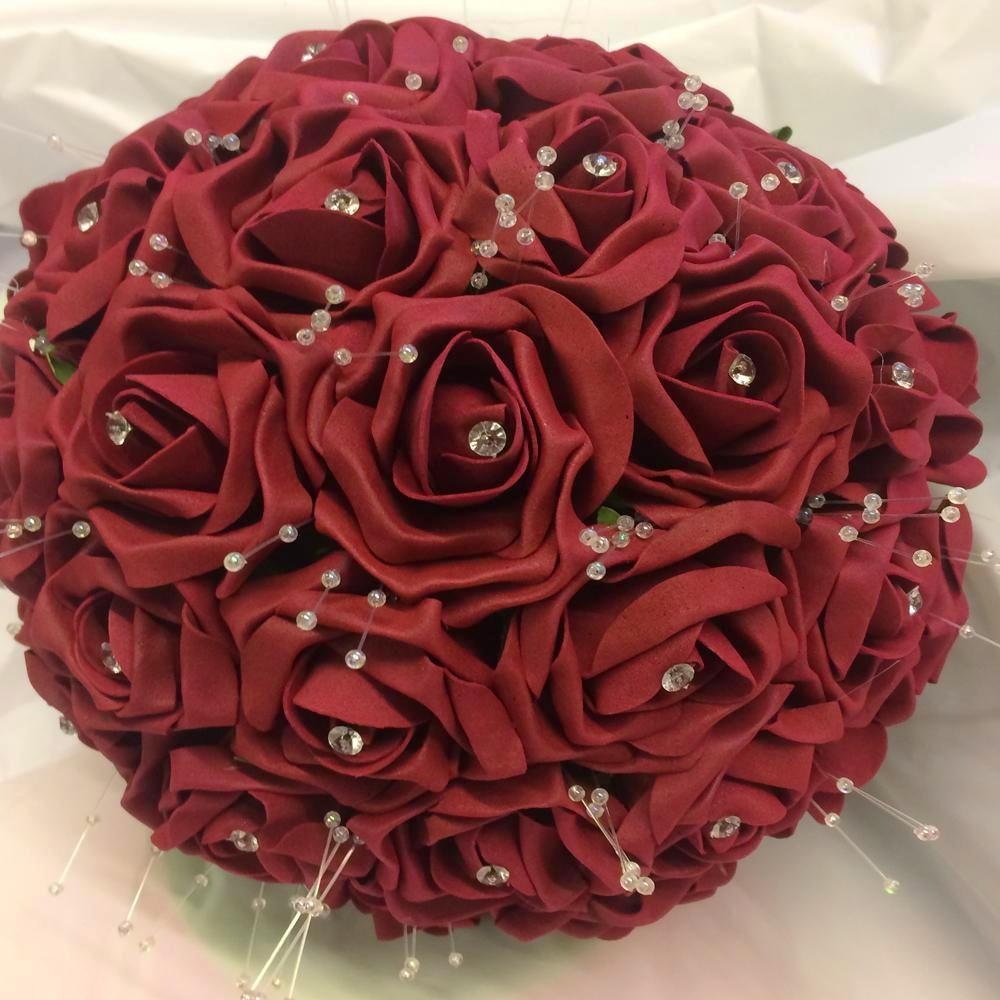 brides bouquet burgundy roses