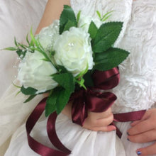 flower girl posy of silk ivory roses