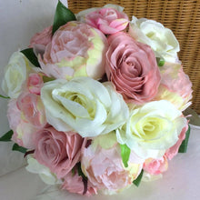 a brides bouquet of artificial silk roses and peonies