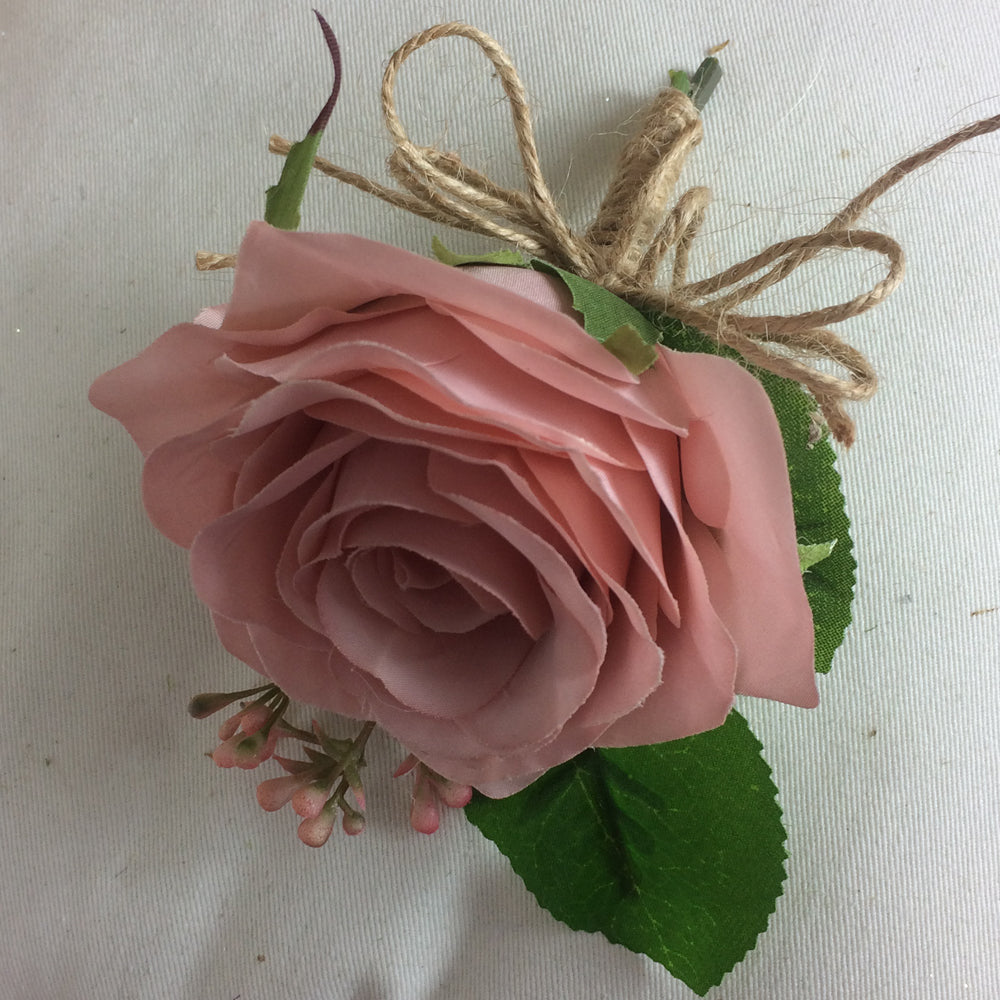 silk wedding buttonhole features dusky pink rose