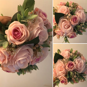 artificial pink roses feature in this weddding bouquet