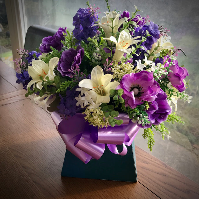 artificial flowers in bouquet box