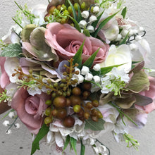 - A hand tied bouquet of dusky pink and ivory artificial roses