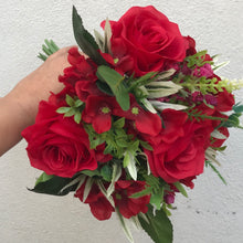A wedding bouquet collection of artificial red flowers