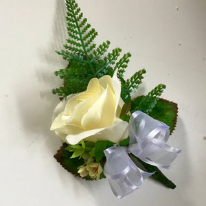 an artificial lemon rose buttonhole