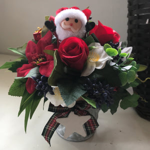 A Christmas arrangement of red and white flowets