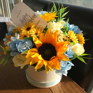 sunflowers and hydrangea in cream hat box