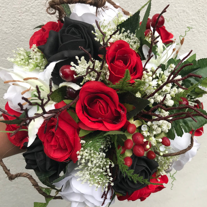 a bridal bouquet of red, black and ivory flowers