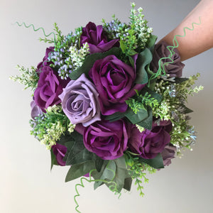 - A wedding bouquet of purple silk and foam roses