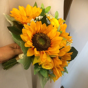 - A collection of wedding bouquets featuring  sunflowers, roses and gysophila