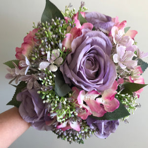 - A wedding bouquet of lilac silk flowers