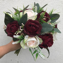 A wedding bouquet of artificial pink and burgundy roses