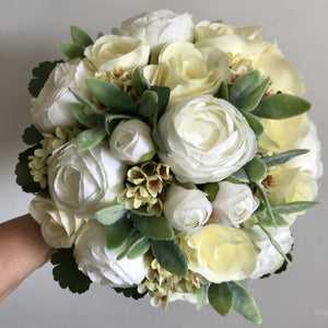 artificial wedding bouquet of lemon and ivory flowers