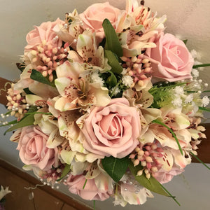 A wedding bouquet of alstromeria, roses and gyp